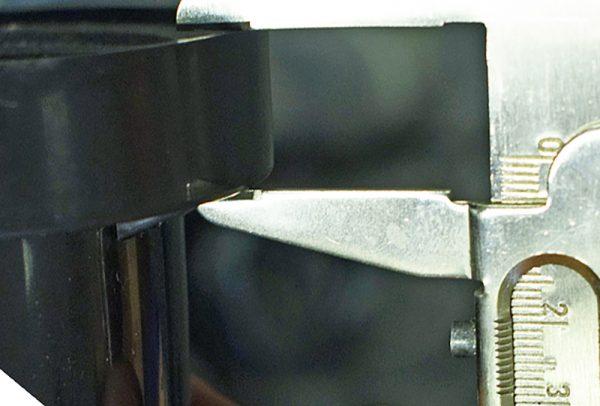 Top of black casing behind front bezel = 19.5mm