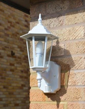 Regent white pir lantern outdoor motion sensor wall light lumena motion sensor wall light in white mozeypictures Images