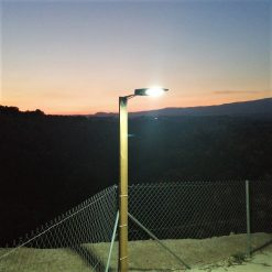 Hiway mounted and illuminated on wooden post